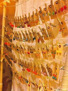cool way to display earrings - attached to a vintage-style price tag and clipped onto some twine with an old fashioned laundry clip.