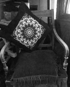 """Apart from their beauty, mandalas may be employed to focus attention as an aid to meditation. The symbolic nature of the mandala is designed to help access progressively deeper levels of the unconscious.  This an 18""""x18"""" medium-weight black cotton pillow (cover only) featuring an inset of one of my original monochromatic B&W mandalas on the front panel. The mandala is printed onto heavy polyester fabric for sharpest image, colorfast reproduction and durability."""