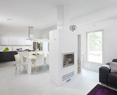 Scandinavian style white living room with a fireplace   Ainoakoti - K-rauta