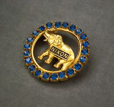 Why don't campaign pins look like this anymore? Where are our priorities??