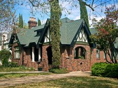 Tudor Style House - love the brick, timber framing combo