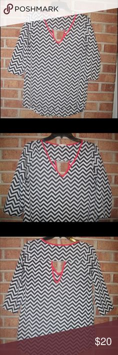 Everly Black & White Chevron Stripe Zig Zag Blouse Small. Length: Approximately 29 inches. Approximately 17 inches from armpit to armpit. Sleeve length: Approximately 16.5 inches from shoulder seam to wrist. 3/4 length sleeves. Chevron stripe print. V- Neck. Triangle cut out in back. Unlined. 100% Polyester. Everly Tops