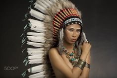 Tribal - Girl wearing Native American Indian headdress and jewelry and face paint