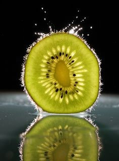 Waterdrop on a kiwi, photography by Karoly Karsay http://1x.com/artist/40573 #still_life #photography #kiwi