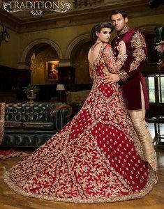 Deep red and gold groom sherwani