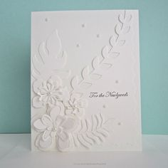 White on white floral wedding card embellished with die cut flowers, faux pearls. The top layer features a die cut leaf motif with fancy Fancy Hands, Basic Grey, Cut Flowers, White Envelopes, Card Sizes, Newlyweds, Floral Wedding, Hand Stamped, Wedding Cards