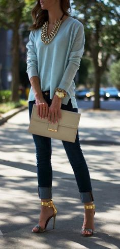 Gorgeous sexy blouse with blue casual jeans and khaki leather plan clutch and golden stylish high heels ladies sandals and golden chain neck...