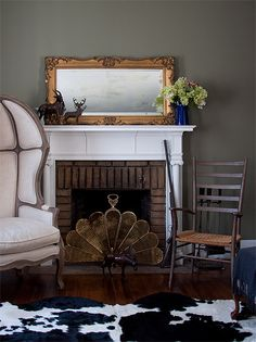 The Living Room is a perfect mixing of old with modern.  The Restoration Hardware linen chairs are offset with some antique finds