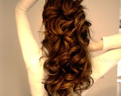 Perfect curls. A trick: spray a bit of leave-in conditioner or dime-sized amount of a smoothing serum (John Frieda Anti-Frizz or Garnier Shine Serum works wonders!). And when using a curling iron, don't clamp the ends. Twirl the hair around the iron while holding on the the end. Hold for at least 10 seconds and release.