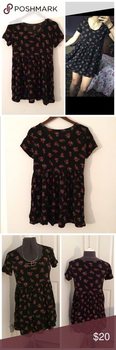 """Rose Nicolette Babydoll Dress Adorable short sleeved """"Nicolette"""" babydoll dress in black and red rose print. Perfect for throwing on year round! Brand: Brandy Melville. Size: One size. Measurements: Bust: 35″ Waist: 34″ Total length: 31″ Very little stretch. Condition: Worn a few times, has a little bit of wear but other than that looks great! Material: Rayon. #boho #hippie #hipster #indie #vintage #retro #babydoll #minidress #babydolldress #floral #roses #floraldress #flowy #spring…"""