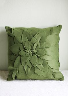 """Kells Bloom Throw Pillow 29.99 at shopruche.com. This small throw pillow in forest green features fabric appliques that create a blooming flower. Hidden side zipper.  Approx. 15""""L x 16""""W"""