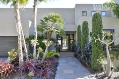 This home from SDHGL shows the stunning result of layering a variety of plants at your home's entrance.   #gardening #entry #home