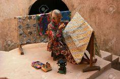 15792766-YOGYAKARTA-SEPTEMBER-14-An-elderly-woman-making-traditional-batik-cloth-at-the-Castle-on-September-1-Stock-Phot