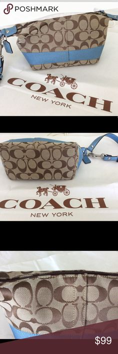 Coach Logo large Wristlet Handbag LN Like new Coach fabric Logo w blue leather adjustable strap. Adjust strap to use as Wristlet or handbag.  Clean in and out.  This was a gift, used once not my style. Larger than a small Wristlet. Fits quite a bit. Looks new. Coach Bags Clutches & Wristlets