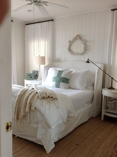 Another fabulous bed by Cisco Brothers is perfect for this beach bungalow master bedroom. + marks the spot.