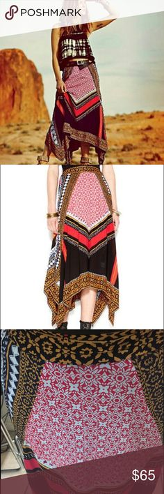 """Free People traveler maxi skirt Beautiful infamous """"Traveler"""" uneven hem maxi skirt from Free People. Red, navy, black, gold and white print on voile. Size small. EUC, only worn twice, it's just a bit too big and I need an xs instead. Waistband is flat in front and ruched stretch in back. Free People Skirts Maxi"""