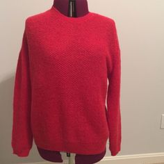 Sweater with Back Zipper Beautiful tomato red sweater with back zipper. Size large. Long sleeves. Crew neck. This is a beautiful lightly woven sweater. 30% nylon; 28% acrylic; 27% mohair; 15% laine-wool. Hand washable or dry clean. Sweaters Crew & Scoop Necks