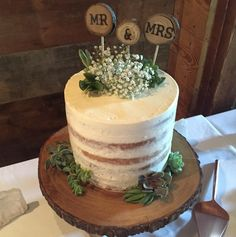 Rustic Naked Cake with Succulents on a wooden cake stand