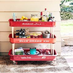 """The song """"Little Red Wagon"""" is one of my favorites to play live and has inspired a lot of DIY projects, too, like this three-tiered bar cart. CL's June issue has more ideas to bring some #littleredwagon swagger to your backyard! --@mirandalambert"""