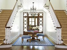 A dramatic double staircase highlights details in the ceiling and banisters - Traditional Home®