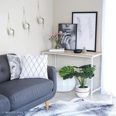 Scandi corner inspo. So many gorgeous products here - Leo the Lion cushion by @tayloreddots_illustrations Via Martine print by @norsuinteriors plant pot by @arcandfamilypots cushion and hanging planters by @seekandstyle and marble letter print by @oliveetoriel. #whitefoxstyling