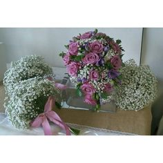 lilac pink bridal bouquet with gypsophila bridesmaids