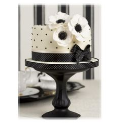 Polka Dotted Black And White Cake With Dotted Ribbon - I think this is so sweet :)