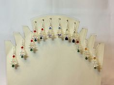 """Look at all the tree earrings Artbeader """"Dot"""" made with our Swarovski margarita beads. Dot says she """"sold every pair I made except for the one pair I kept!"""""""