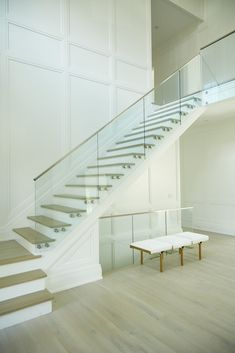 This home in Southampton, NY, features glass railing—our latest modern railing innovation. Our revolutionary standoff pins attach the glass panels to create a minimalist masterpiece. Modern Staircase Railing, Staircase Interior Design, Staircase Contemporary, Interior Stair Railing, Stair Railing Design, Home Stairs Design, Stairs Architecture, Modern Stairs, Glass Stair Railing
