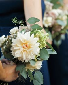 This bride's 'maids all carried dahlias, hydrangeas, and eucalyptus leaves at the couple's farmhouse wedding