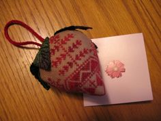 Quaker Strawberry cross stitch pin cushion. I have this pattern... should make it