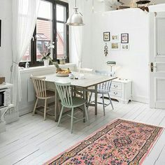 Check out this pretty pink vintage rug!