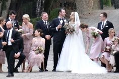 "The [i]Vogue[/i] cover girl wore a frothy gown with lace sleeves and a dramatic veil when she [link url=""http://www.vogue.co.uk/article/kate-upton-wedding-pictures""]wed Detroit Tigers pitcher Justin Verlander[/link]. The traditional dress matched her romantic setting: the Rosewood Castiglion Del Bosco resort in Tuscany, Italy."