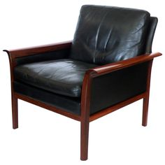 Rosewood and Leather Armchair by Hans Olsen   From a unique collection of antique and modern armchairs at https://www.1stdibs.com/furniture/seating/armchairs/