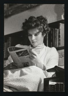 Kate - Classy with a Newspaper: From the NYPL Digital Gallery