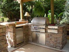 postazione cucina con barbecue esterna
