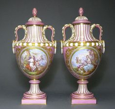 A Pair of Sevres Pink Ground Jeweled Enamel Covered Urns