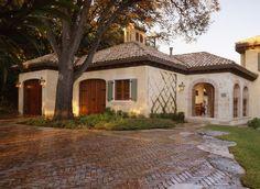 Mediterranean Residence / Exterior Elevation ~ Tile Roof, Wood Doors, Chimney Detail, brick driveway