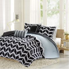 Olliix Intelligent Design Nadia Comforter Set ID10-362 - Olliix Intelligent Design Nadia Comforter Set ID10-362Nadia Makes Any Bedroom Fun And Inviting. The Comforter Features A Modern Solid Grey Color With A Black And White Chevron Print That Runs Along The Bottom Broken Up By White Vertical Stripes. The Shams Feature The Coordinating Black And White Chevron Pattern With A Grey Flange. The Comforter And Sham Reverses To A Solid Black Color. The Set Comes With Two Coordinating Black And…