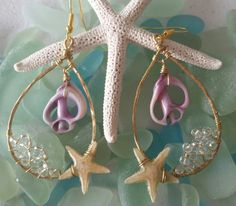 Small purple sliced shell, and thunder polish crystals. Real starfish carefully layered with resin to obtain durability. Tarnish free wire is