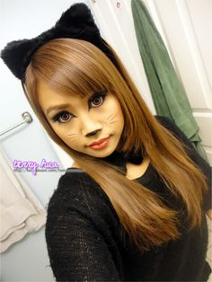 cat makeup for Halloween and I love the contacts!!