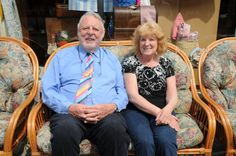 Sylvia, Emmaus customer, talking to Terry Waite and enjoying the sunshine outside one of our shops