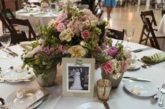 family wedding photos as table numbers