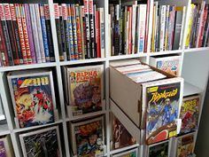 Comic storage @David Nilsson Fry. A good combination of graphic novel shelves and comic book box storage space.
