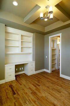White on white built-in bookcase and desk. Would love to do this in spare room upstairs