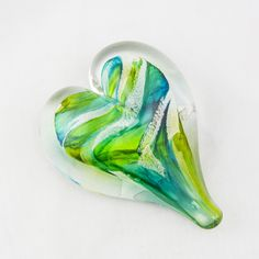 - Green and yellow heart shaped paper weight sympathy gift made of hand blown glass. - Each of these paper weights is unique in the various shades of green and yellow. - Hand blown glass is an artisan