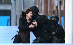 Sydney cafe attack - Rob Griffith, File In this Dec. 2014 file photo, a hostage runs to an armed tactical response police officers for safety after she escaped from a cafe under siege at Martin Place in the central business district of Sydney, Australia. Dark Pictures, Pictures Of The Week, Powerful Images, Most Powerful, Ferguson Riot, Current Events News, Tactical Response, Sydney Cafe, Picture Editor