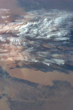 "earthstory: ""Delicate clouds over the Lybian desert. Clouds that may look imposing to those of us stuck underneath can appear like lacy gossamer from above, as evidenced by this image from the space station. Pale Blue Dot, Planet Earth, Earth 2, Earth From Space, Space Travel, Cartography, Aerial Photography, Stars And Moon, Earth Tones"