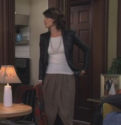 Robin's black leather jacket with brown skirt on How I met your mother.  Outfit Details: http://m.wornontv.net/527/