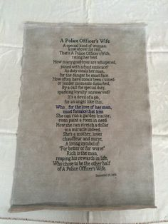 "A 10x21 hand stitched poem. ""A Police Officer's Wife"" cross stitch. Fiber art. Needle work. Contact foreverinstitches13@gmail.com for free estimates!"